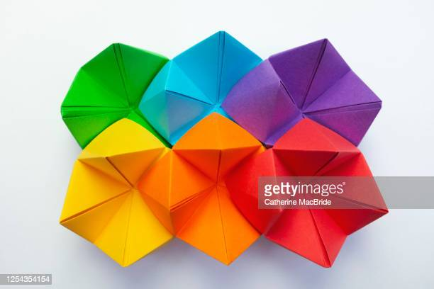 folded paper rainbow origami - catherine macbride stock pictures, royalty-free photos & images