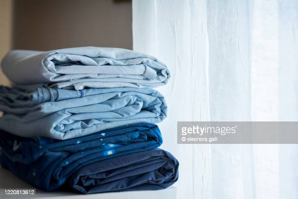 folded sheets - sheet bedding stock pictures, royalty-free photos & images