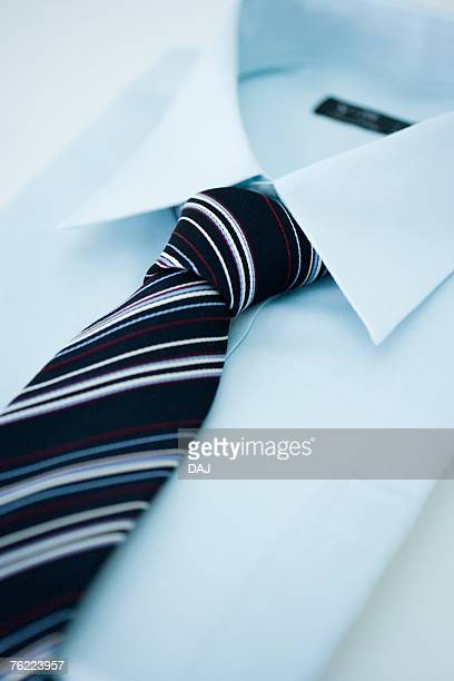 Folded shirt and tie, high angle view, close up, white background, Japan
