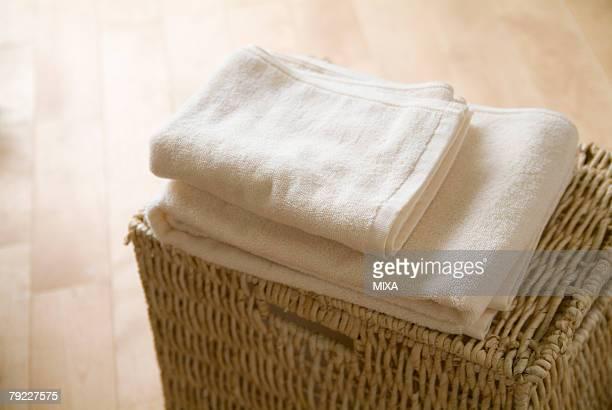 Folded towels on a basket