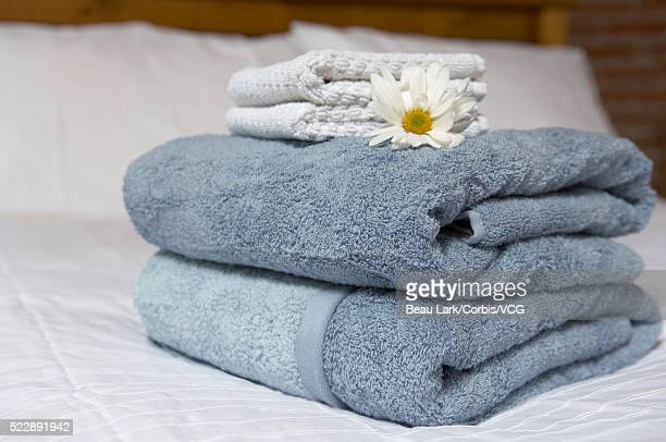 Folded towels on bed