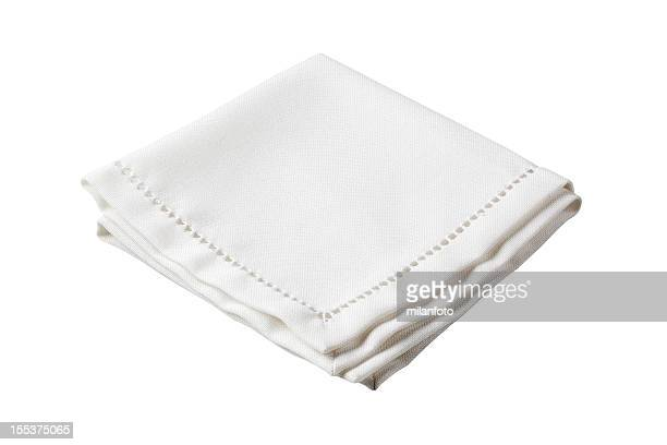 Folded white napkin with embroidered border