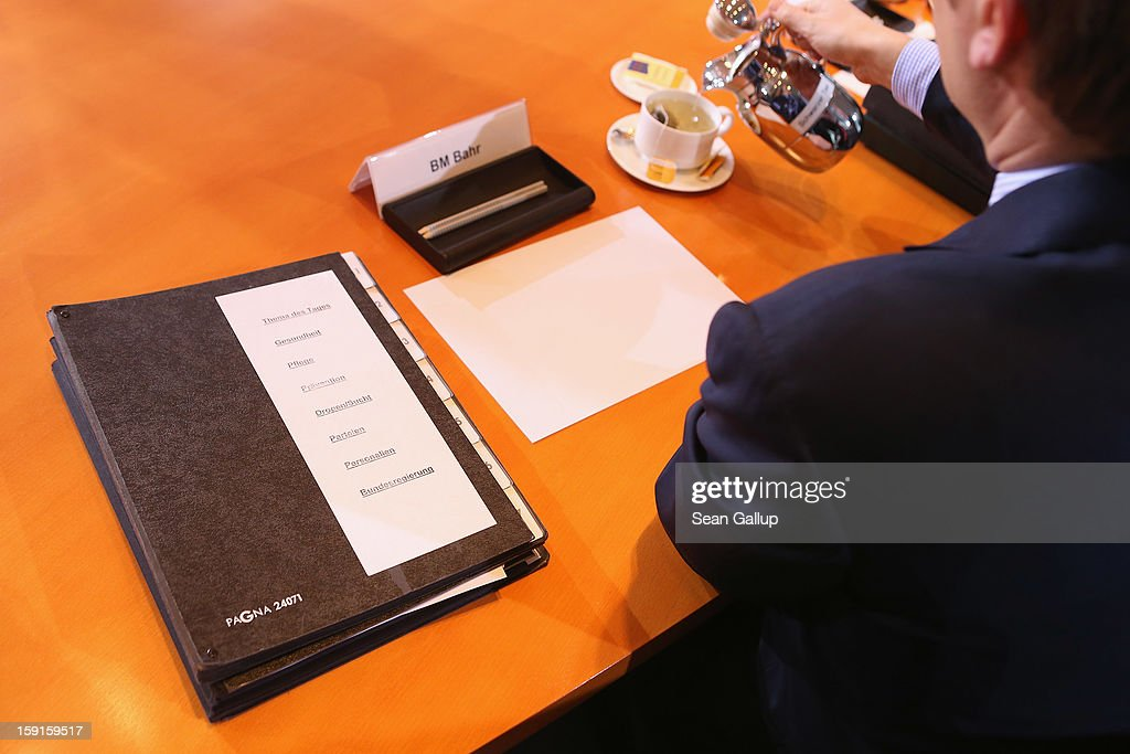 'Topic Of The Day,' 'Health,' 'Care,' 'Prevention' and 'Drugs/Addiction' lies next to Health Minister Daniel Bahr as he serves himself tea upon his arrival for the weekly German government cabinet meeting on January 9, 2013 in Berlin, Germany. High on the morning's agenda was the latest government culture and education report.