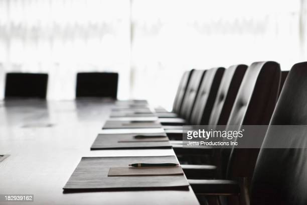folders and pens on meeting table - conference table stock pictures, royalty-free photos & images