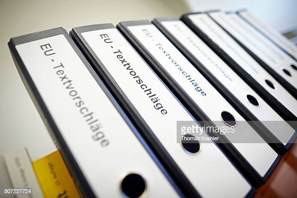 Folders are pictured on a shelf during a presentation of the TTIP documents reading room at the Economy Ministry in Berlin on January 28 2016 German...