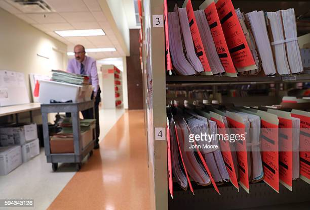 Folders of immigrants' permanent residency applications await processing at the US Citizenship and Immigration Services Texas Service Center on...