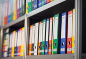 folders on bookshelf