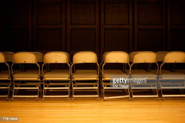 Folding chairs sit empty before Republican presidential candidate and former New York City Mayor Rudy Giuliani speaks at Iowa State University...