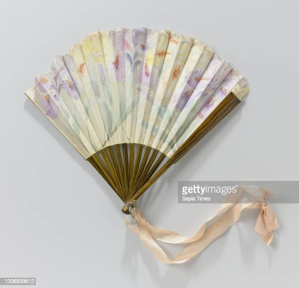Folding fan with a cream colored silk leaf painted with yellow and lilac irises on a frame painted with wood paint Folding fan with a cream colored...