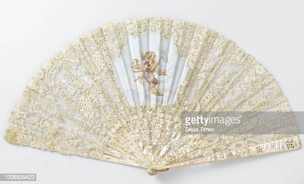 Folding fan with a motherofpearl frame and an application side leaf with painted silk insert with musicmaking angels Folding fan consisting of a...