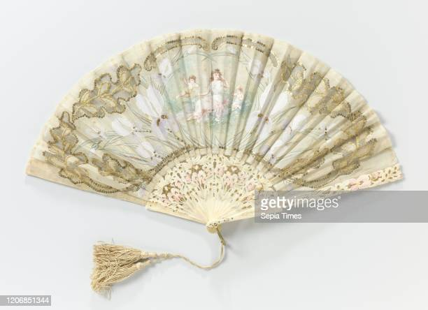 Folding fan with a representation of a nymph and two putti in a border of irises Folding fan with leaf of batist decorated with copper lovers and...