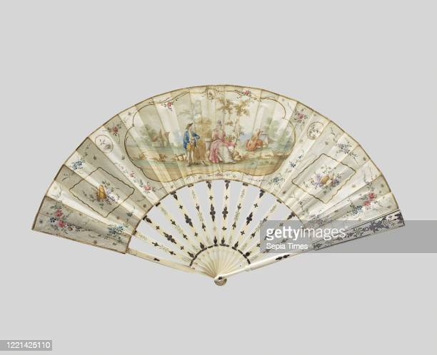 Folding fan with a sheet of paper On which in watercolor a cartouche with pastoral representation on a frame of embossed ivory with silver leaf Ivory...