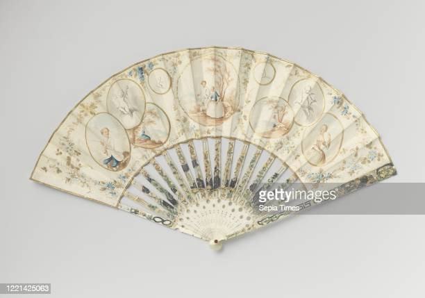 Folding fan with leather leaf front with nine medallions as grisailles or in sepia colors rear sitting woman at bossage on an ivory ajour frame and...