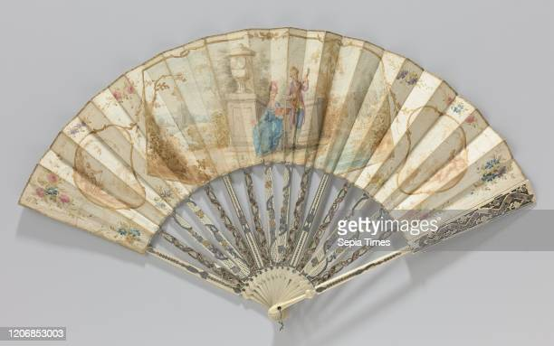 Folding fan with sheet of paper on which a watercolor painting of a couple in a landscape near a ruin carved frame adorned with 'mŽtal and quatre...