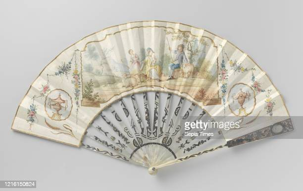 Folding fan with thin leather leaf on which a pastoral scene has been painted with watercolor on a frame of motherofpearl lace and embossed with...