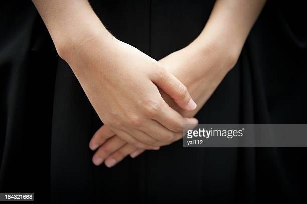 ripiegare le mani - funerale foto e immagini stock