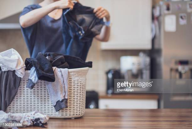 folding laundry at home - laundry stock pictures, royalty-free photos & images