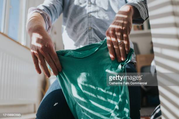 folding laundry - tumble dryer stock pictures, royalty-free photos & images