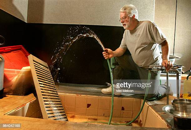 Foley artist John Roesch demonstrates spraying water against an old metal organizer to simulate the sound of leaks and drips landing on metal debris...
