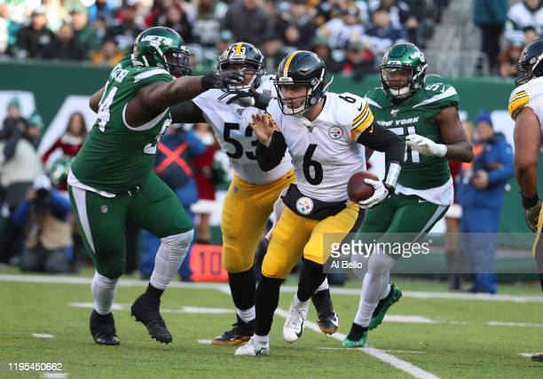 Foley Fatukasi of the New York Jets sacks Devlin Hodges of the Pittsburgh Steelers during their game at MetLife Stadium on December 22, 2019 in East...