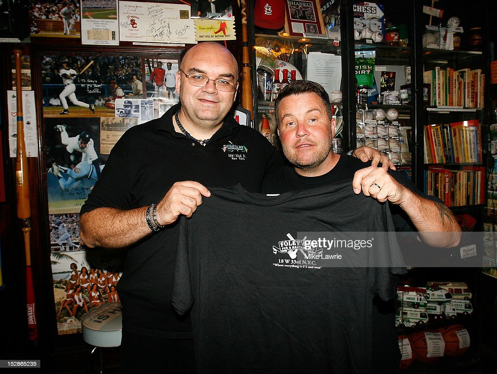 Foley's owner Shaun Clancy (L) poses with Musician Ken Casey of Dropkick Murphys as Casey guest bartends as part of a Super Bowl XLVI wager at Foley's NY Pub on September 27, 2012 in New York City. Casey, who owns McGreevy's Bar in Boston, lost a Super Bowl bet to Foley's owner Shaun Clauncy.