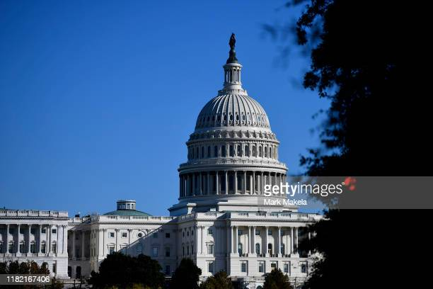 Foliage frames the US Capitol Building on November 13 2019 in Washington DC In the first public impeachment hearings in more than two decades House...