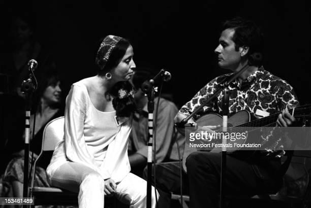 Folk and blues singers and musicians Maria Muldaur and Geoff Muldaur perform at the Newport Folk Festival in July 1968 in Newport Rhode Island