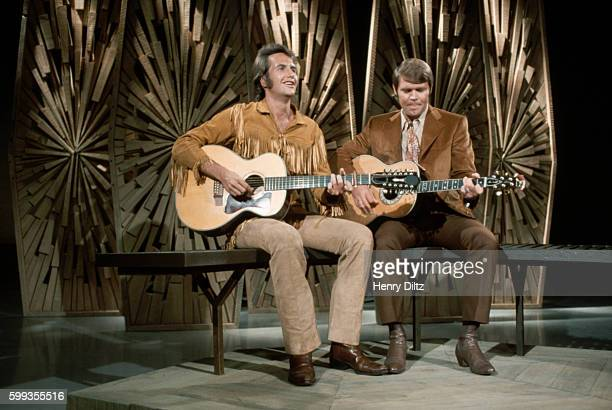 Folk and country singer John Stewart performs with Glen Campbell on a television special