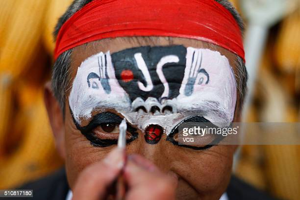 A folk artist is making up before the Blood Shehuo parade to celebrate the lunar new year on February 15 2016 in Baoji Shaanxi Province of China...