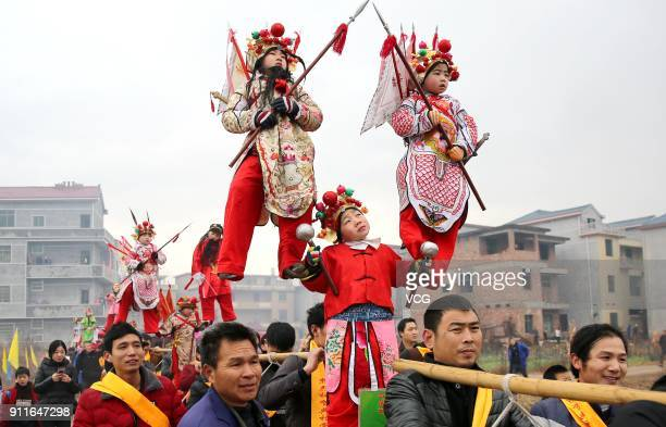 Folk artists participate in a Taige parade during a Chinese New Year celebration at Huangcun village on January 28 2018 in Jishui China Taige is an...