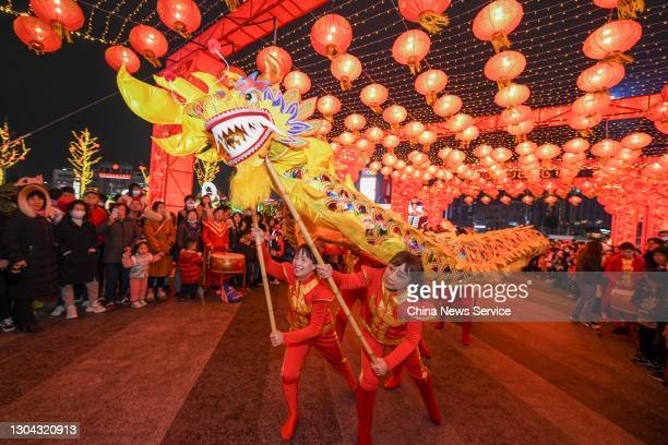 Folk artists perform dragon dance during a lantern show to celebrate the Lantern Festival at a shopping mall on February 26, 2021 in Changsha, Hunan...