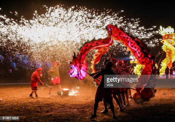 Folk artists perform dragon dance in the splash of molten iron during a Chinese new year celebration on February 14 2018 in Shangqiu China 2018 is...