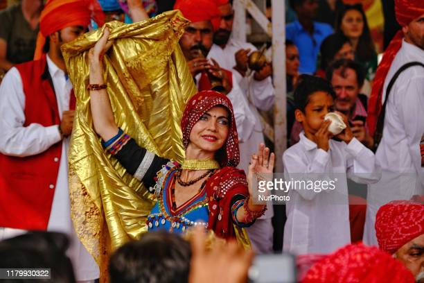 Folk artists perform during th Pushkar Fair Rajasthan India Nov 04 2019 Thousands of livestock traders from the region come to the traditional camel...