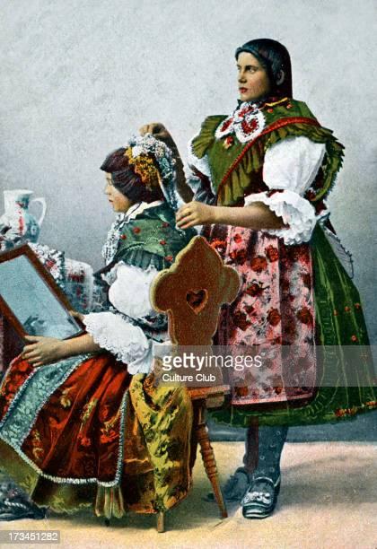 Folk costumes in Barany Hungary Caption 'Romanyai viselet'