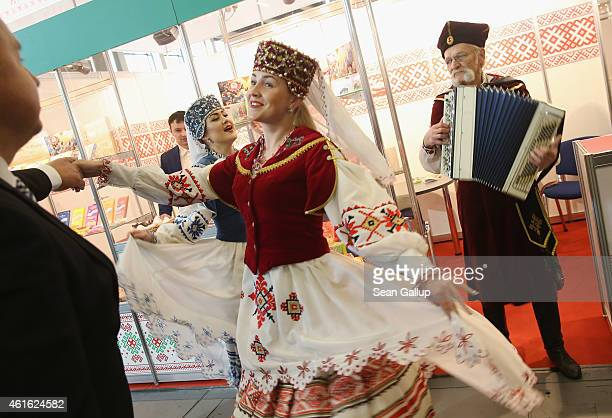 Folk dancers and singers from Bulgaria perform at the International Green Week agricultural trade fair on January 16 2015 in Berlin Germany The...