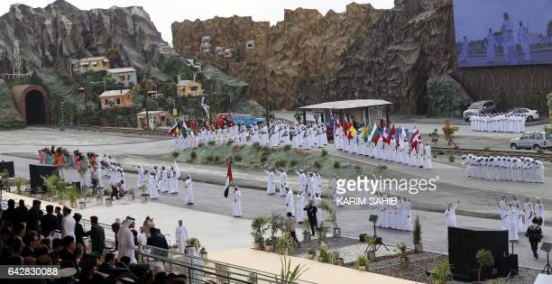 Folk dancers entertain the crowd during the opening of the International Defence Exhibition and Conference in the Emirati capital Abu Dhabi on...