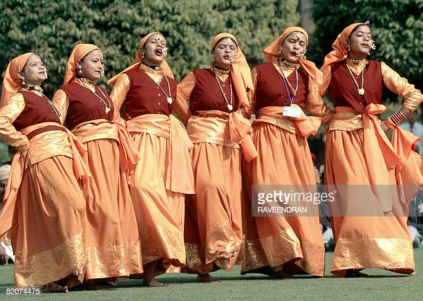 Folk dancers from the Indian state of Uttaranchal perform a routine in front of the unseen Indian President APJ Abdul Kalam at The Presidential...