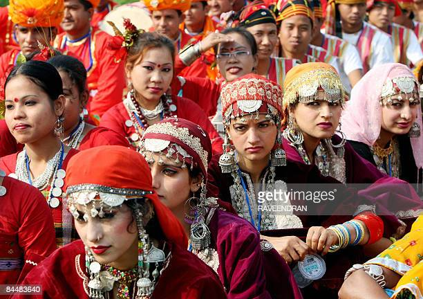 Folk dancers from the Indian states of Kashmir and Tripura await the arrival of Indian President Pratiba Devi Singh Patil to perform a dance routine...
