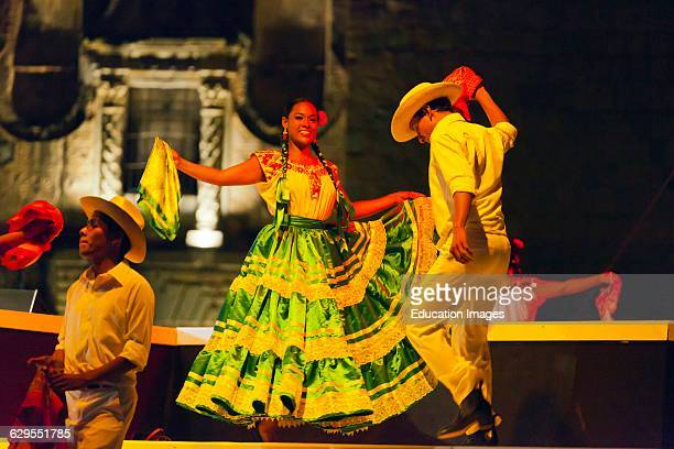 Folk Dancers Perform In The Plaza De La Danza During The Guelaguetza Festival In July Oaxaca Mexico