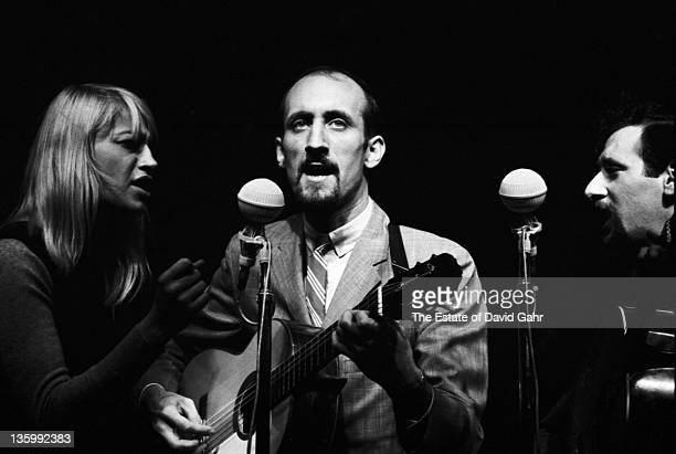 Folk group Peter Paul and Mary perform at the Newport Folk Festival in July 1964 in Newport Rhode Island