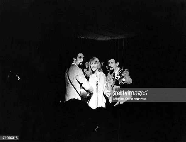 Folk group Peter Paul Mary perform on stage in circa 1965