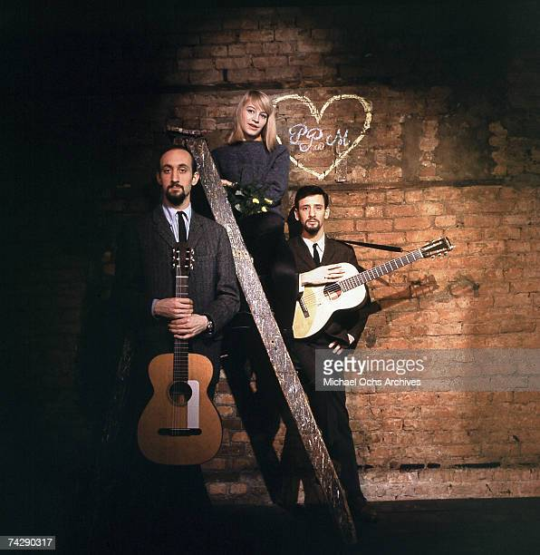 Folk group Peter Paul Mary pose for a portrait session for the outtakes of their first album which was released in 1962