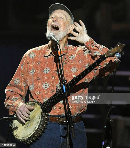 Folk music legend Pete Seeger performs during a concert marking his 90th birthday at Madison Square Garden in New York on May 3 2009 Proceeds from...
