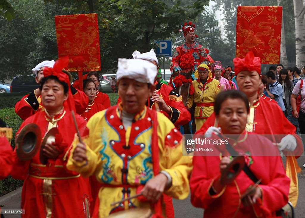Folk Music Performers Parade As The Groom Sits On A Horse During An Ancient Style Wedding