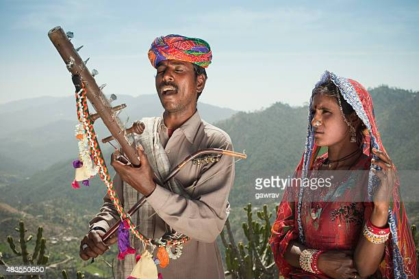 Folk musician couple of Rajasthan, India singing and playing Ravanahatha.