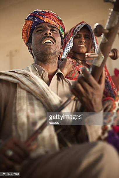 folk musician couple of rajasthan, india singing and playing ravanahatha. - indian music stock photos and pictures