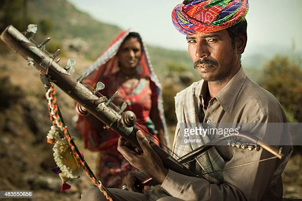 folk musician of rajasthan, india playing ravanahatha in hills. - folk music stock pictures, royalty-free photos & images