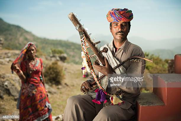 Folk musician of Rajasthan, India playing Ravanahatha in hills.