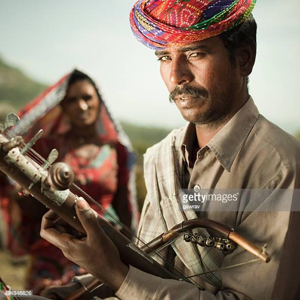 Folk musician of Rajasthan, India playing Ravanahatha in hills.
