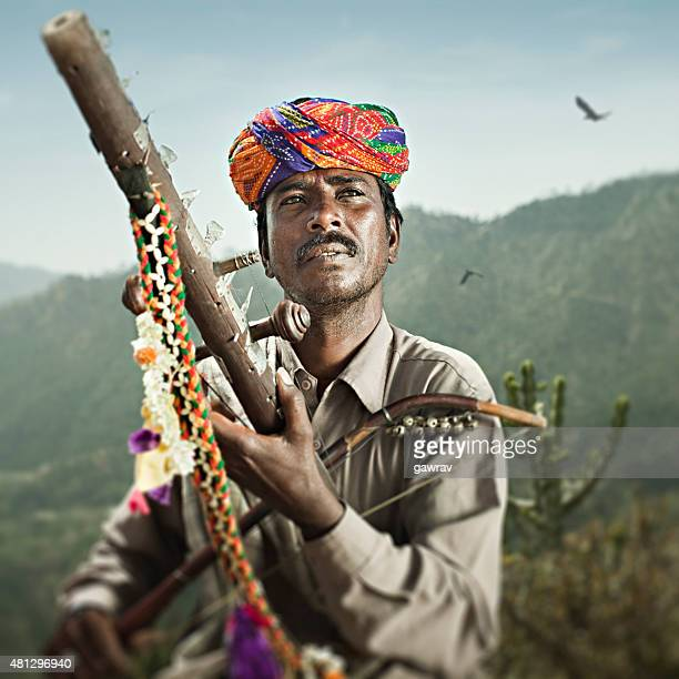 folk musician of rajasthan, india playing traditional musical instrument ravanahatha. - indian music stock photos and pictures